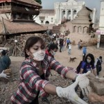 Nepalese people clear rubble at the Basantapur Durbar square in Kathmandu on May 1, 2015, following a 7.8 magnitude earthquake which struck the Himalayan nation on April 25. Desperate survivors living at ground zero of Nepal's earthquake felt abandoned to their fate after losing their loved ones and livelihoods in a disaster that has claimed more than 6,300 lives. AFP PHOTO / Nicolas ASFOURI        (Photo credit should read NICOLAS ASFOURI/AFP/Getty Images)